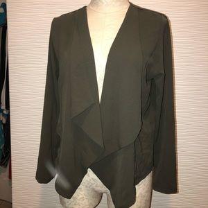 Thin material blazer- ends above waist!